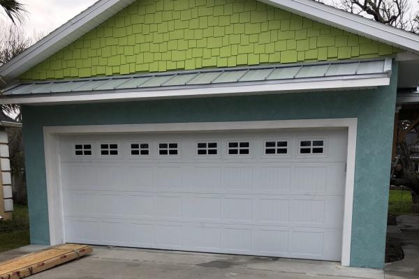 Carriage Stamp Garage Door with Stockton Glass Top Section