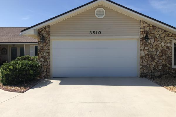Insulated Garage Door with Flush Panel Design