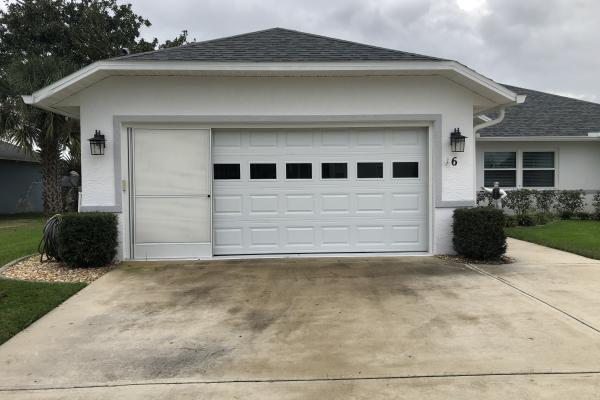 Raised Short Panel Garage Door with Plain Glass