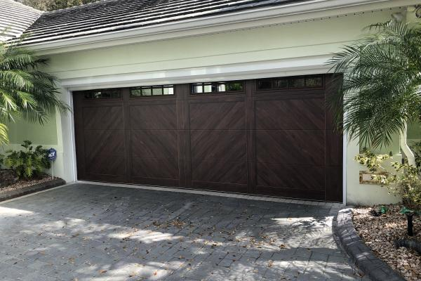 Accents Woodtones Flush Carriage House Garage Door with Madison Glass Top Section