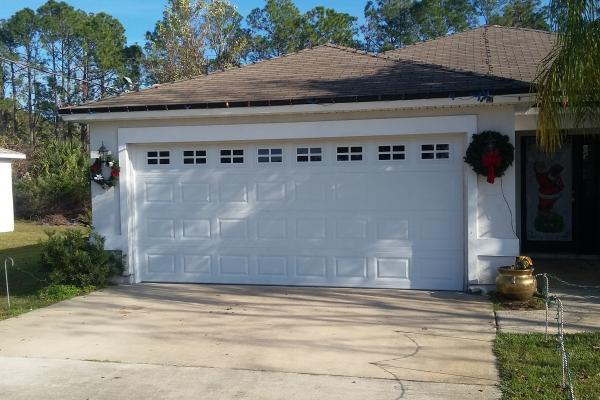 Raised Short Panel Garage Door with Glass Top Section Stockton Design