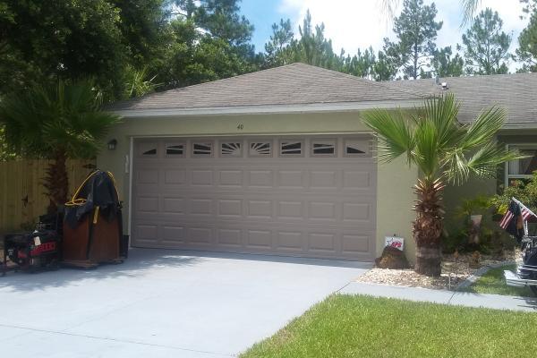 Raised Short Panel Garage Door with Sunburst Design Glass Top Section