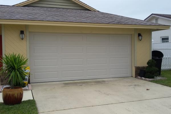 Raised Long Panel Garage Door in Almond