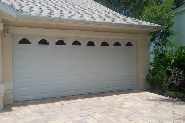Raised Short Panel Garage Door with Cathedral Glass Top Section