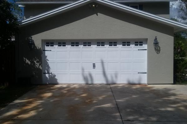 Carriage Stamp Short Panel Garage Door with Stockton Glass Top Section and Spade Hardware