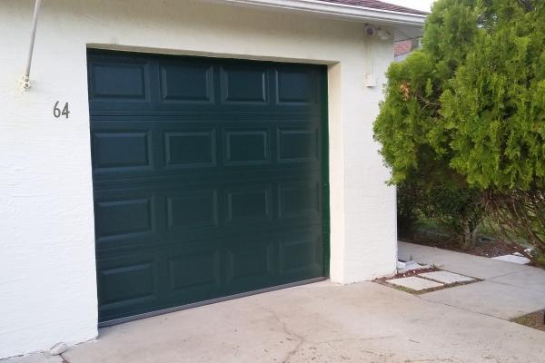 Raised Short Panel Garage Door in Evergreen
