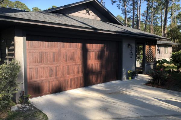 Accents Carriage Stamp Short Panel Garage Door in Mahogany